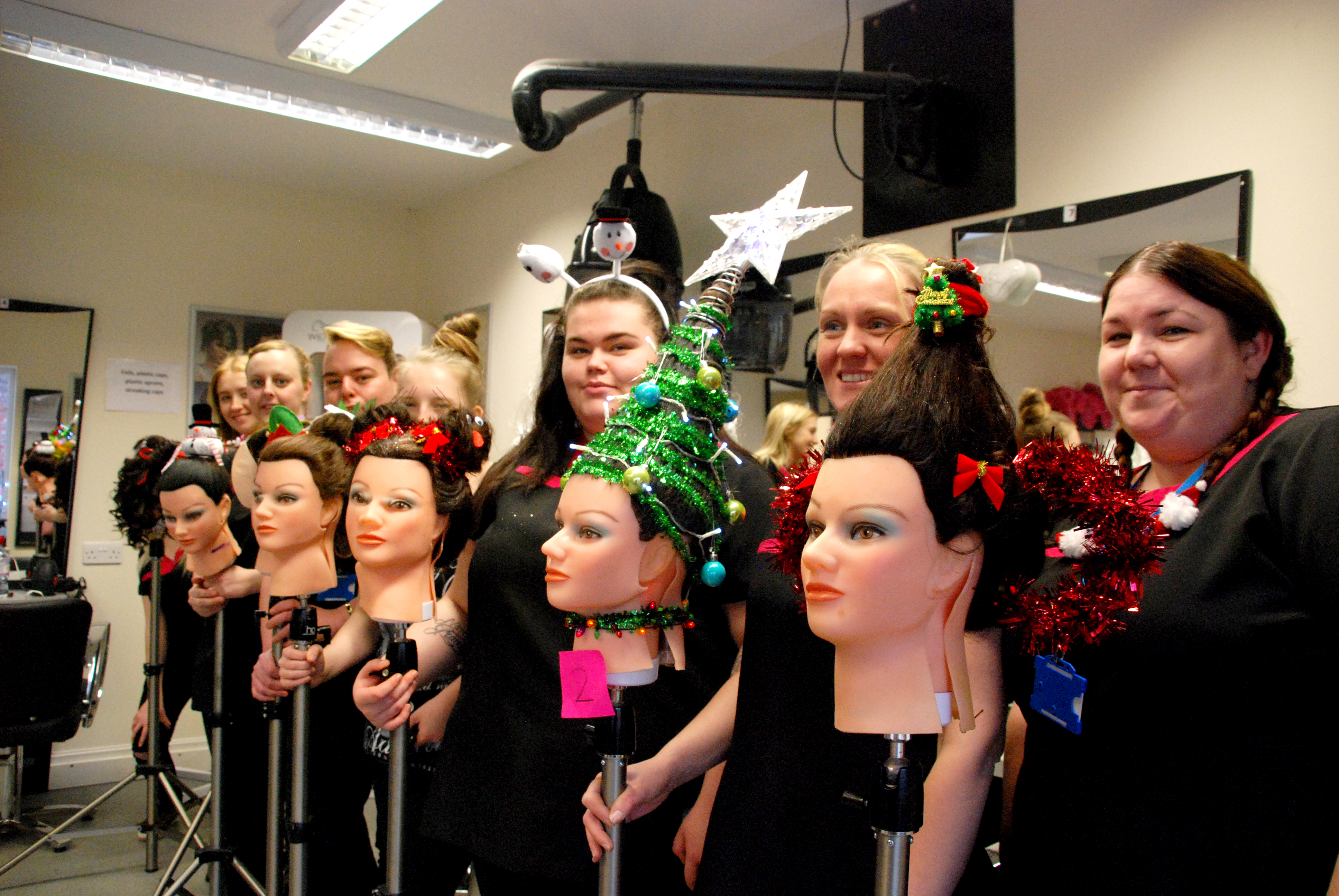 Hairdressing students with their Christmas Hair designs