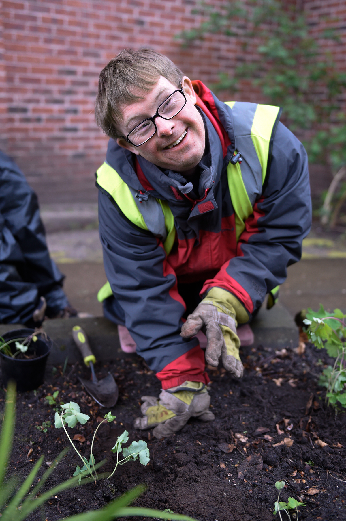 Gardening student Graham planting in the Greenbank College grounds