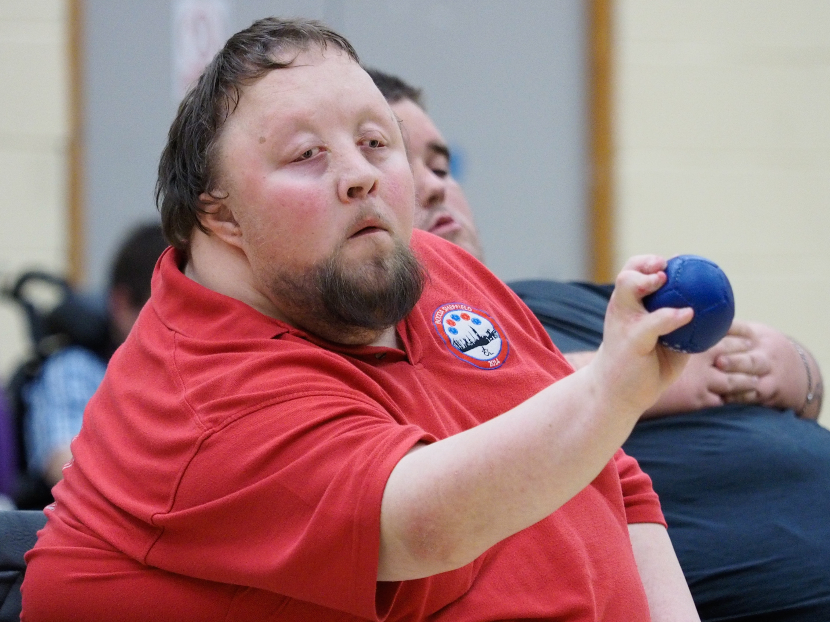 Person concentrating on his shot in Boccia