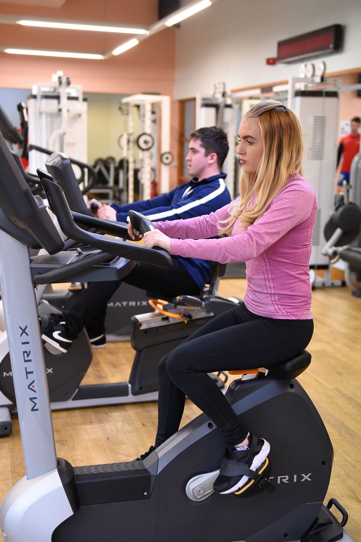Personal training students using the gym equipment
