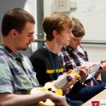 Greenbank College students learning to play the Ukelele at one of their enrichment sessions