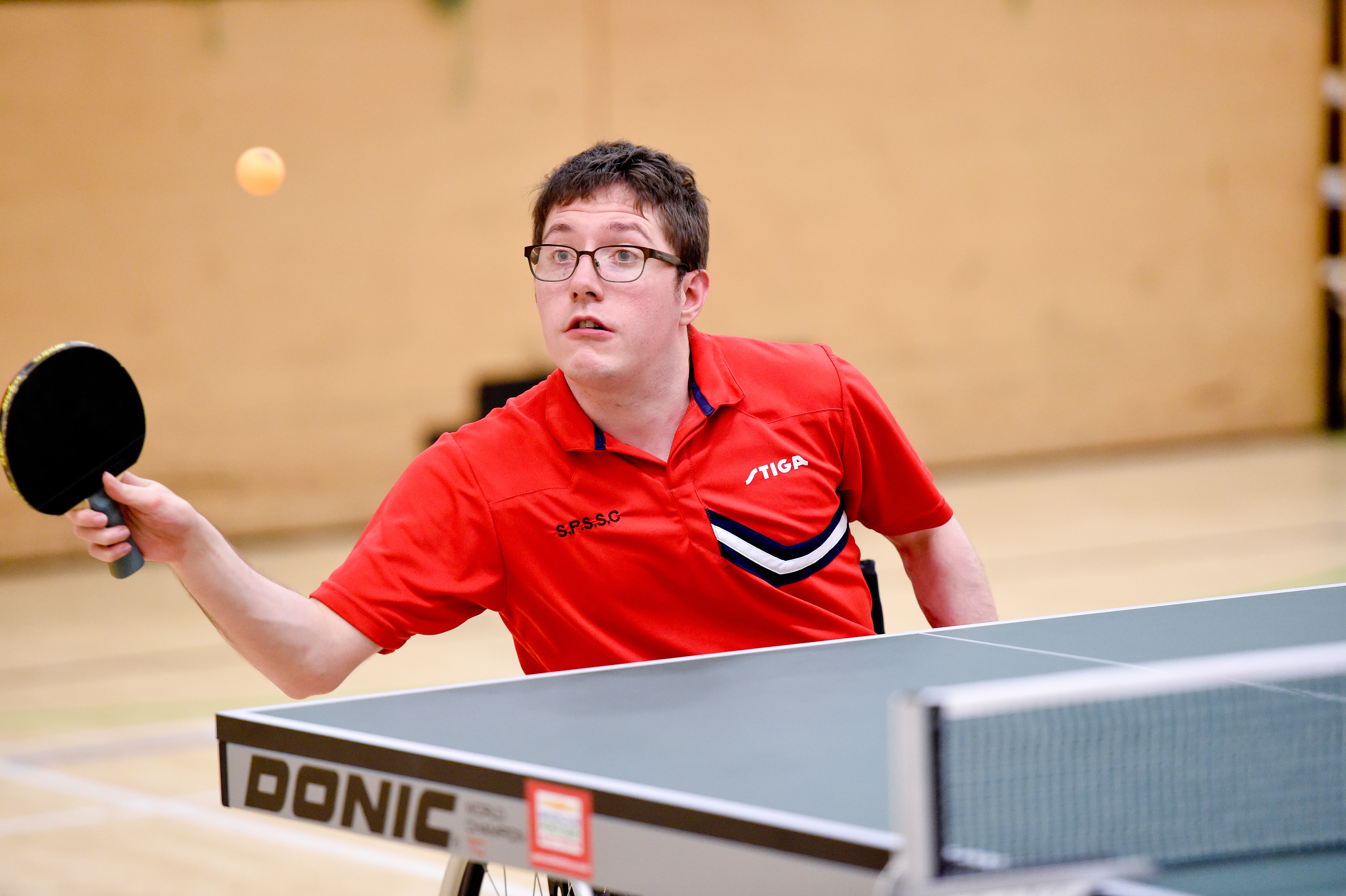Wheelchair user playing table tennis