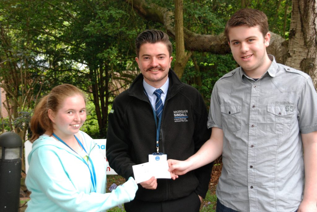 Morgan Sindall representativeJonathan Duckett presents cheque to Greenbank College students